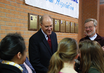 Bill Buzenburg '64 chats with MHS students in front of Wall of Fame at MHS West. The award winning journalist was in Manhattan for his induction into the MHSAA Wall of Fame. The complete story may be found in the Spring 2008 Alumni Mentor.