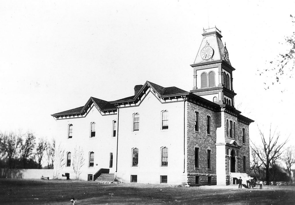 Central School 1878 Ivy would later cover the walls, the clock tower would come down, and East and West Wings would be added. Photo courtesy of The Riley County HIstorical Society.