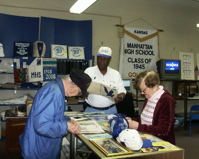 1944 class members are deep into the abundance of MHS history offered by the Alumni Center.