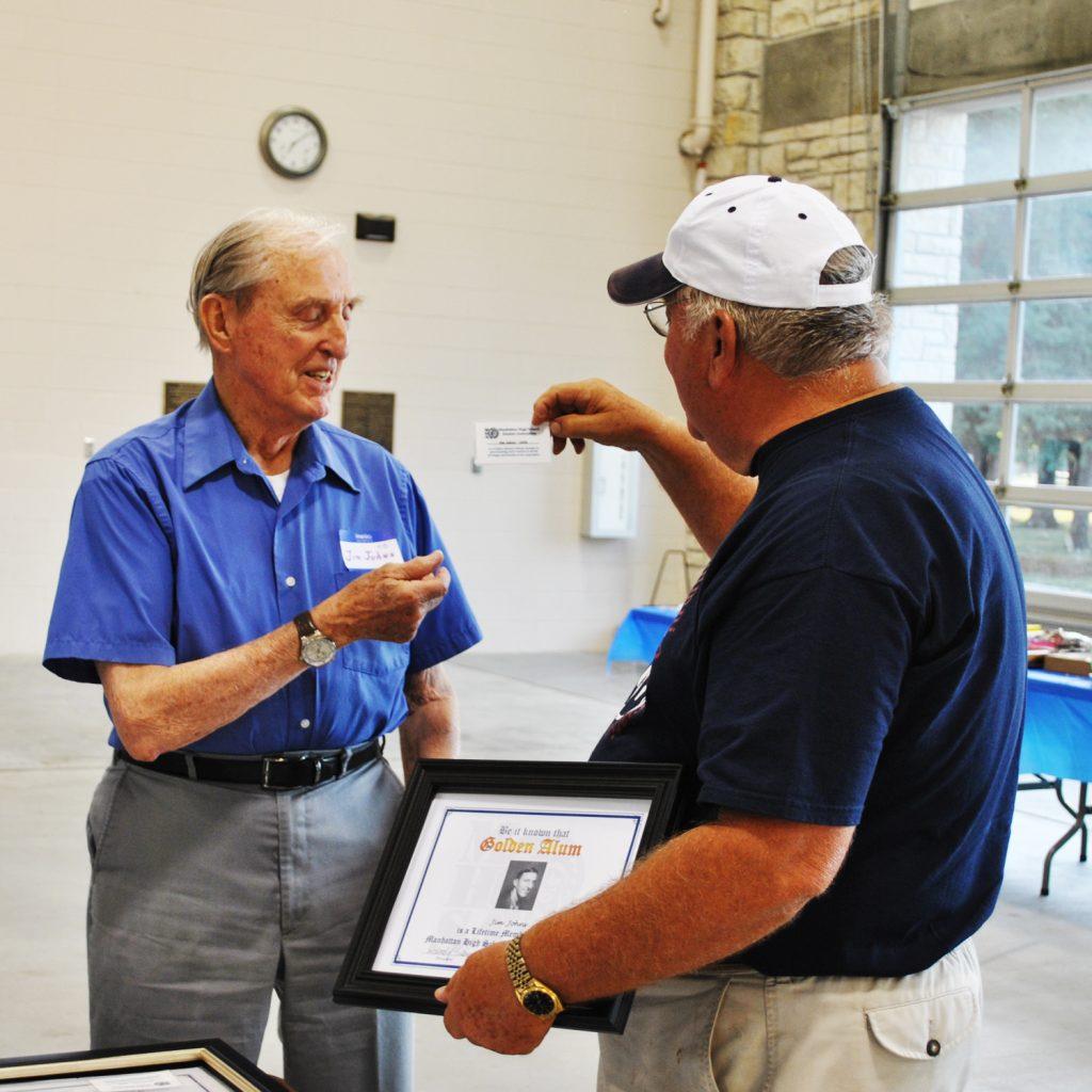 Jim Johns receives Golden Alumn lifetime card from Dave Fiser.