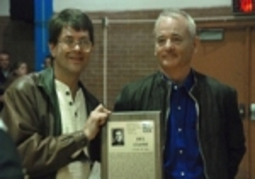 Bill Murray displays the plaque he received on behalf of Del Close along with Howard Johnson, author of The Funniest One in the Room: The Lives and Legends of Del Close.