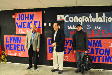 Lynn Meredith, John Weigel, and Dawayne Bailey in front of the large WELCOME MHSAA sign made by MHS students.