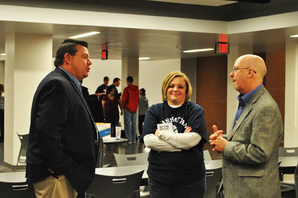 Lynn Meridith, right, talks with MHS principal Terry McCarty, left, and Michele Jones.