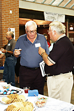 Dave Fiser and Charlie Hostetler at the social table during the social portion of the Wall of Fame dedication.