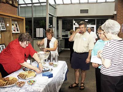 Carita Otts and Pat Petty serving at the social table.