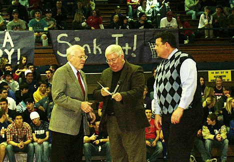 Tom Romig receives his Wall of Fame award, after which he spoke to the MHS students.