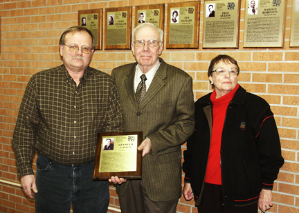 Ed Albrandt, Ralph and Mary Ellen Titus with the Davis Wall of Fame plaque.