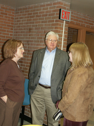 Diane Gaede-Shilling '65 and Jayne (Foster) Peterson '66, two of a group of classmates and friends of Tom Romig, talk with Roger Brannon, former MHS teacher, debate coach, and influence in the life of Hall of Fame Honoree Mike Silva.