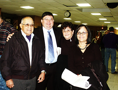 A reception was held in the MHS West cafeteria before the 2009 Wall Of Fame Induction Ceremony. Mike Silva poses with his family, from left to right: Mike's father Richard Silva, MHS class of 1950, Mike, Mike's mother Genita Silva, Mike's sister Janet Silva Perez class of 1974.